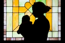The stark silhouette of a woman and her child, Women's Mosque of America, February 2015.