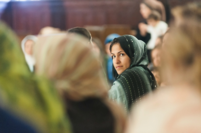 A nameless woman glances back after prayer has ended at the Women's Mosque.